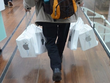 GROUPS OF FORIEGN MEN AFTER QUEUEING ALL NIGHT AT WESTFIELD SHOPPING CENTRE TODAY PICTURE JEREMY SELWYN 16/03/2012