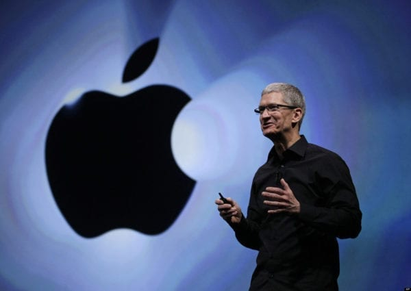 FILE - In this Wednesday, Sept. 12, 2012, file photo, Apple CEO Tim Cook speaks following an introduction of the new iPhone 5 in San Francisco. Apple is emerging as a gentler, cuddlier corporate citizen in the year after the death of CEO and co-founder Steve Jobs. CEO Tim Cook's announcement that the company is moving a Mac production line to the U.S. is just the latest step in a charm offensive designed to soften Apple's image. (AP Photo/Eric Risberg)